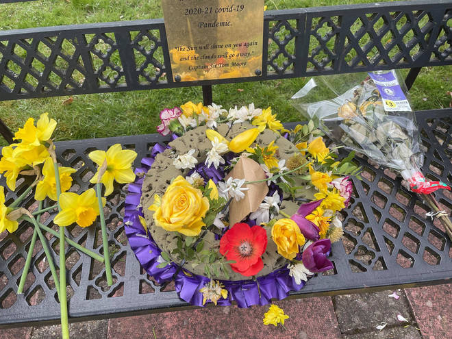 Flowers were pulled from a wreath commemorating people who died from Covid-19