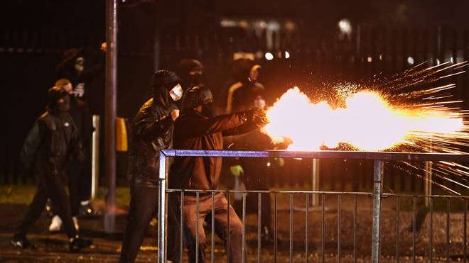 Rioters were seen throwing fireworks at police officers in west Belfast