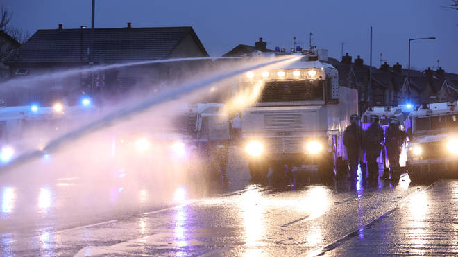 Police responded to the rioters by firing a water cannon at them