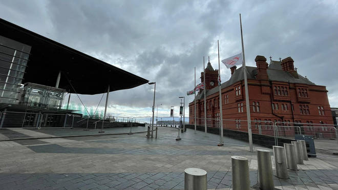 Flags were lowered at half-mast outside the Senedd in Cardiff, Wales