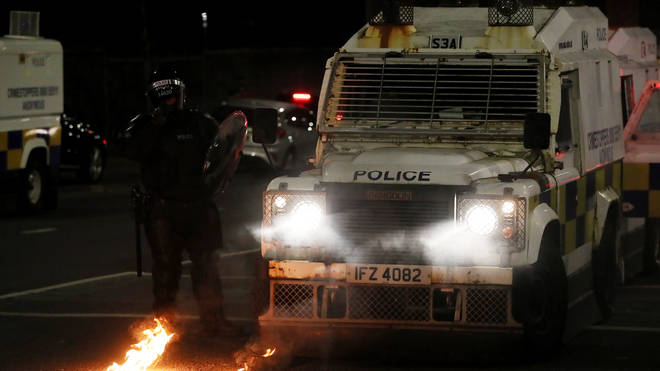 Police were pelted with petrol bombs and masonry during three hours of disorder on Friday, the PSNI said
