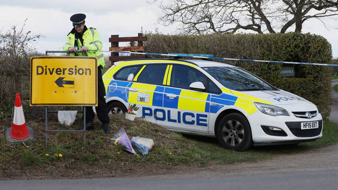 Police at a cordon at the junction of Moor Lane and Langham Lane in Gillingham, Dorset, following the death of Sir Richard Sutton