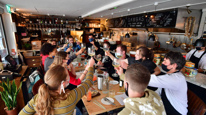 Members of staff take part in a menu tasting at Gambas Tapas Bar in Wapping Wharf, Bristol, as they prepare to reopen for outdoor dining