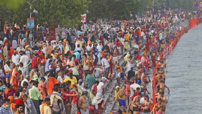 Devotees take holy dips in the River Ganges during Shahi snan or a Royal bath at Kumbh Mela, in Haridwar in the Indian state of Uttarakhand