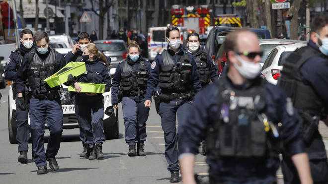 Police officers leave the scene after a shooting in Paris