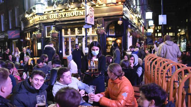 Customers receive their drinks in Soho