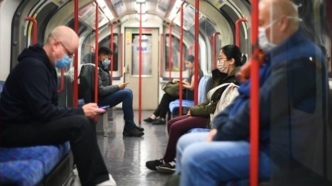 Passengers wear face masks on the tube