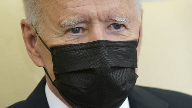 Joe Biden wearing black face mask over his nose and mouth