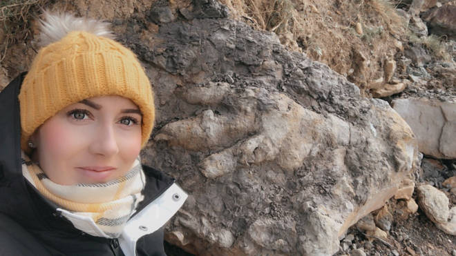 Archaeologist Marie Woods found the dinosaur fossil while collecting shellfish on the beach