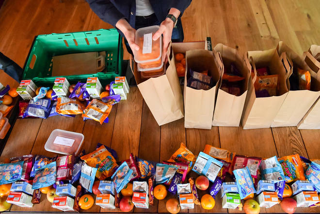 A scheme to help families with food and bills has been extended