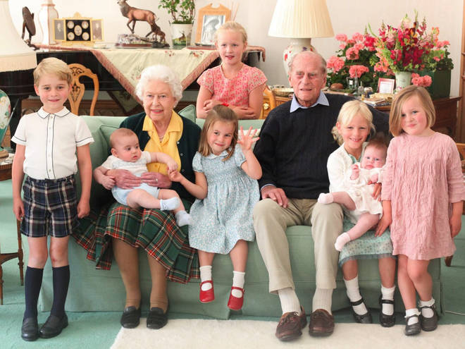 The Royal Family have released previously unseen pictures of Prince Philip, pictured here with the Queen and seven of their great-grandchildren