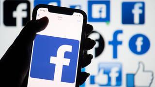Facebook logo on phone