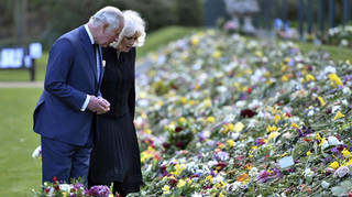 Prince of Wales and Duchess of Cornwall have viewed flowers left by the public in memory of the Duke of Edinburgh