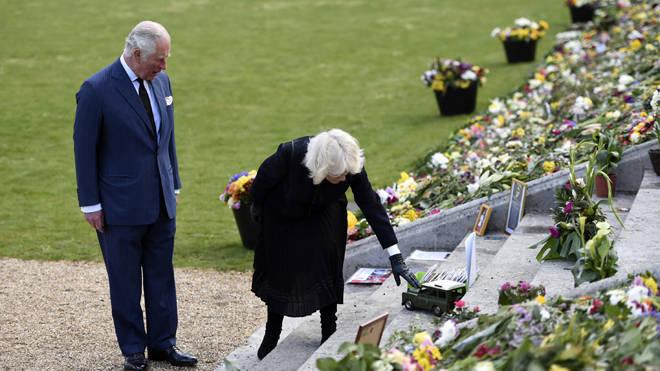 Charles and Camilla viewed the sea of tributes at Marlborough House Gardens