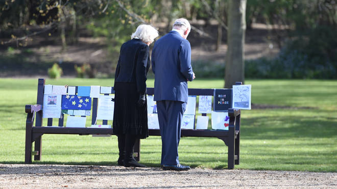Charles and Camilla read messages left for the Duke of Edinburgh