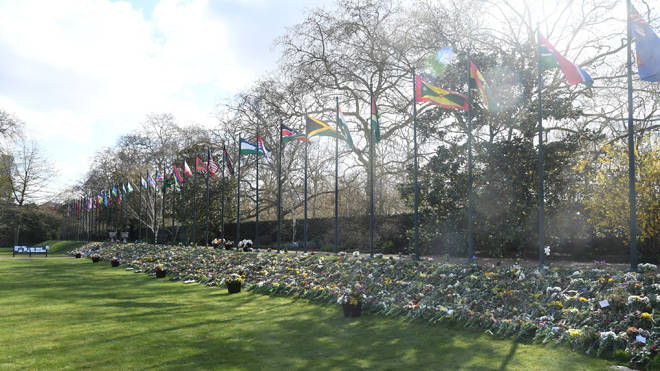 The flowers, tributes and messages left by members of the public outside Buckingham Palace