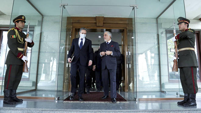Abdullah Abdullah, Chairman of the High Council for National Reconciliation, walks with US Secretary of State Antony Blinken, at the Sapidar Palace in Kabul