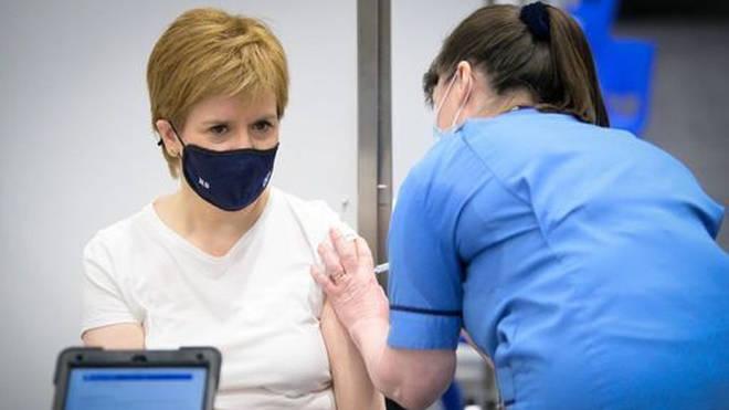 Nicola Sturgeon receives her first shot of the Astra Zeneca vaccine