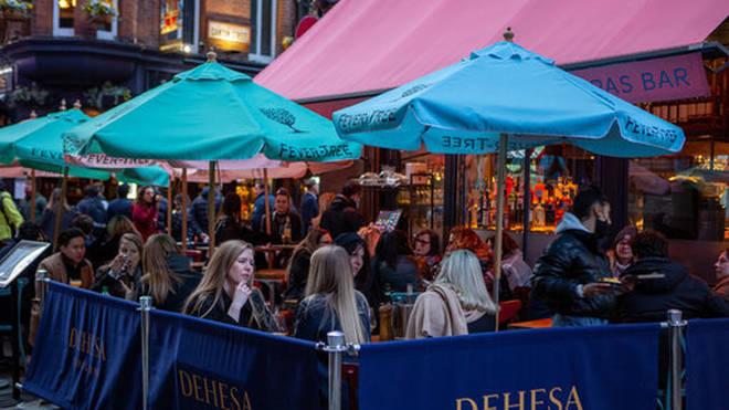 People enjoying drinks in Carnaby Street area
