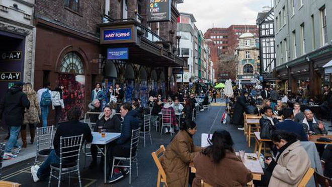 Crowds fill tables in Old Compton Street in Soho