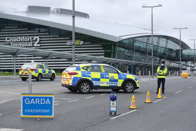 Garda perform Covid-19 stop checks outside Terminal 2 at Dublin Airport