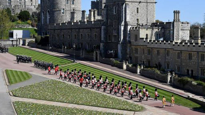 The Foot Guards Band are seen marching outside St George's Chapel