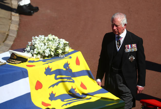 The Prince of Wales pays his respects behind his father's coffin