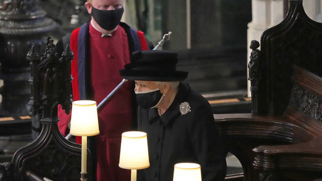 Queen Elizabeth II takes her seat in St George's Chapel, at Windsor Castle, Berkshire, for the funeral of the Duke of Edinburgh.