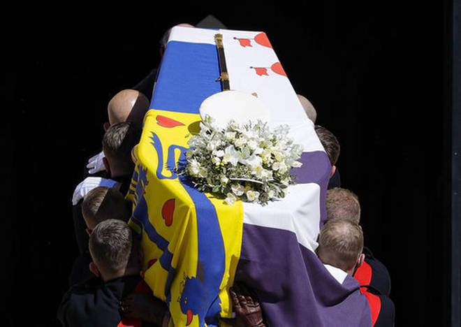 The coffin is carried inside St George's Chapel for the funeral of Prince Philip