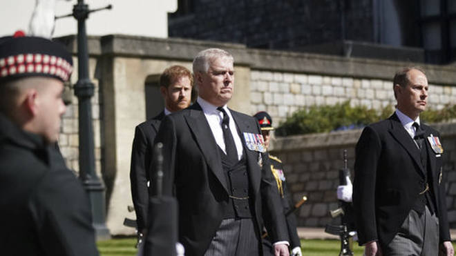 Prince Andrew, centre, Prince Harry and Prince Edward, in the procession