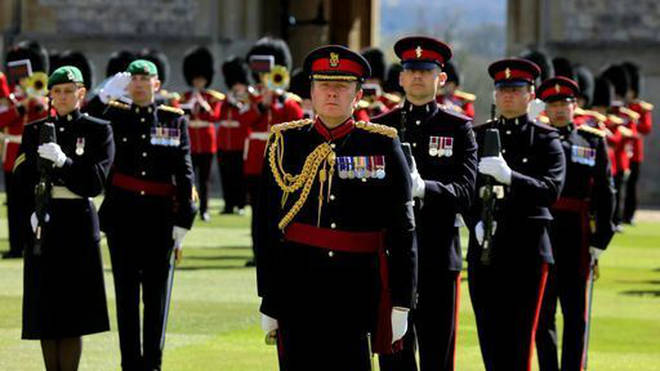 Members of the Military observed a minute's silence ahead of the funeral