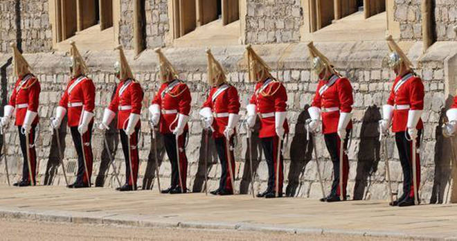 Members of the military line the Quadrangle in Windsor Castle