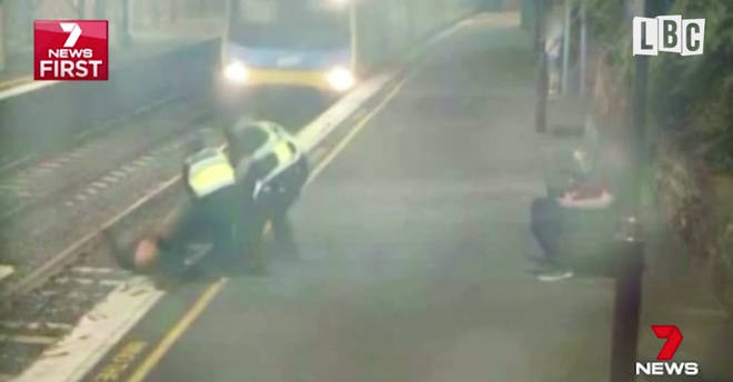 Hero PSOs save woman from oncoming train