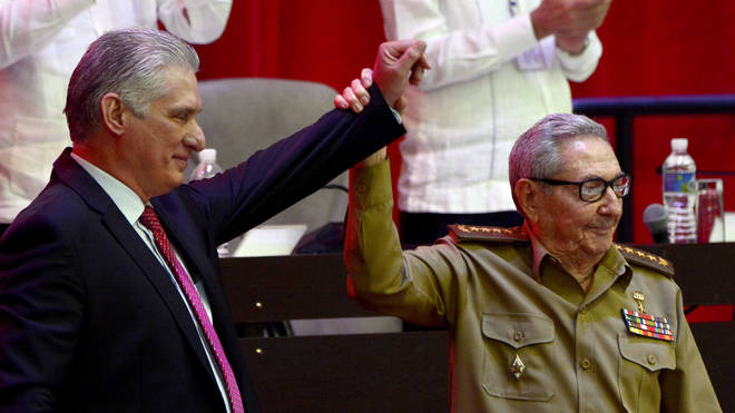 Raul Castro, right, raises the hand of Cuban President Miguel Diaz-Canel after he was elected First Secretary of the Communist Party at the closing session of Cuban Communist Party's 8th Congress at the Convention Palace in Havana, Cuba