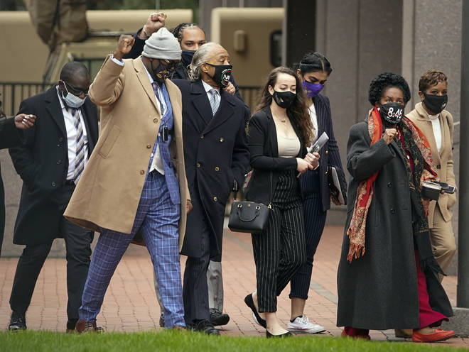 Rev Al Sharpton and Philonise Floyd (second from left), brother of George Floyd, arrive along with Congresswoman Sheila Jackson (second from right) at Hennepin County Government Center
