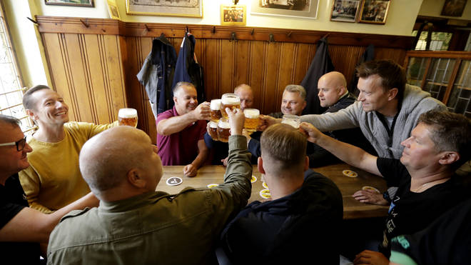 Customers cheer with beer at a pub in Prague, Czech Republic