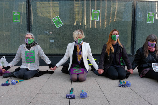 """The group sat down outside HSBC&squot;s Canary Wharf headquarters and """"waited to be arrested""""."""