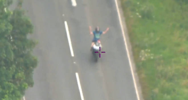 Police helicopter footage showed Alex Sartain waving to them as he rode along at high speed.