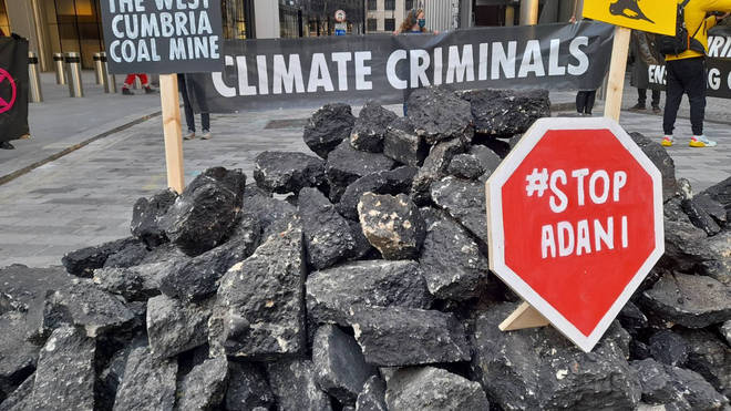 Extinction Rebellion activists have tipped 'coal' outside Lloyd's of London insurance market