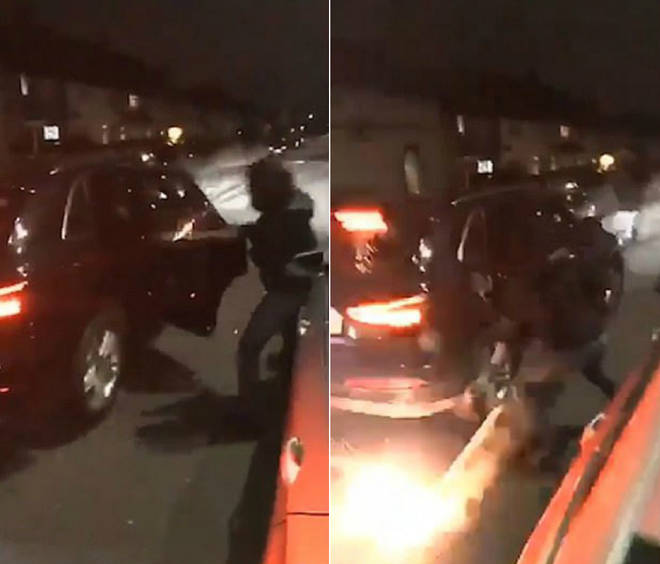 A hooded man throws a lit firework into a stranger's car