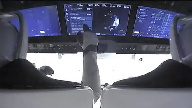 Astronauts in the cockpit of the SpaceX Crew Dragon spacecraft after lift off