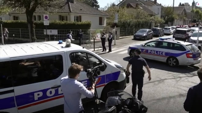 Police near the scene of a stabbing at a police station in Rambouillet, south-west of Paris