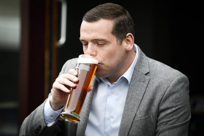 Scottish Conservatives leader Douglas Ross enjoys a pint at an Edinburgh pub