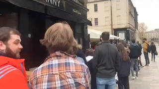 People queue for the pub in Glasgow