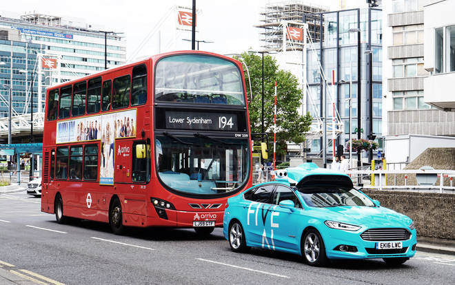 File photo showing a self-driving car in front of a London bus two years ago