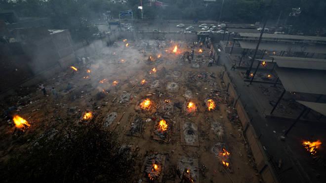 Mass cremation of COVID-19 victims at old Seemapuri crematorium ground in New Delhi