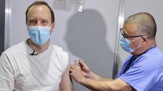 Professor Jonathan Van Tam gives Matt Hancock his covid jab