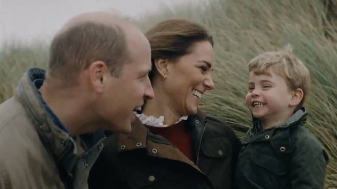 The couple smile at their youngest son Prince Louis in the clip