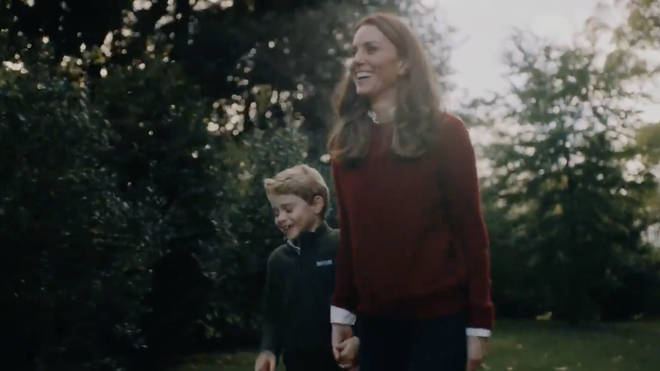 Prince George smiles as he walks with his Mum