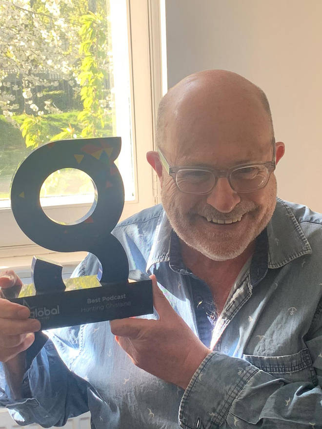 John Sweeney displays his award